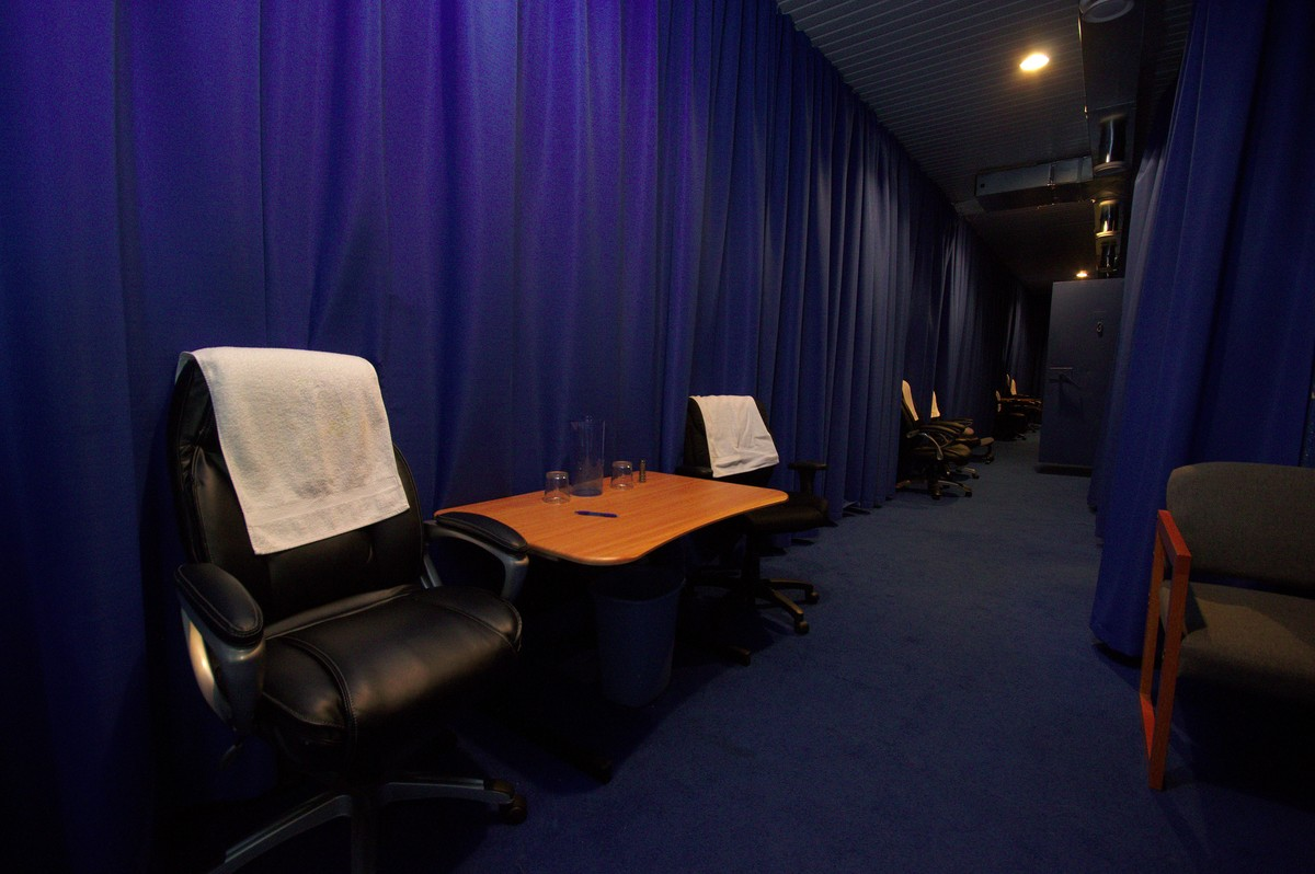 Comfy chairs line the hallway that connects to the training chambers